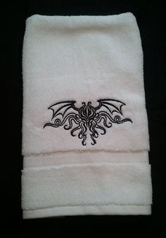 HP Lovecraft's Cthulhu embroidered bath towels on Etsy, $30.00