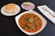 A popular Punjabi classic dish made with chole (chickpeas) and served with bhatura (deep fried bread). Indian Vegetarian Dishes, Chana Masala, Celebration, Ethnic Recipes, Kitchen, Food, Cooking, Kitchens, Essen