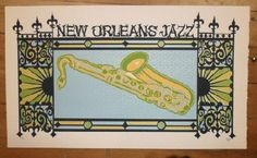 Original silkscreen art print poster for New Orleans Jazz from 2011. It is printed on Watercolor Paper with Acrylic Inks and measures around 13 x 22 inches.  Print is signed and numbered 10 out of only 50 by the artist Tripp.