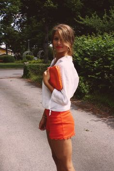 Side bangs, orange, button downs and shorts, bright orange lips. Love the bright orange lips and tan skin!