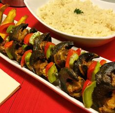 Grilled snail with attieke (Ivorian food)
