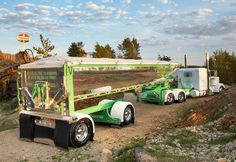 White Peterbilt w/ green pinstripe flames and chromed out end dumped pic2