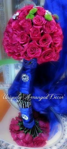 Pomegranate (Fushia) and Cobalt Blue (Royal Blue) fresh bride's bouquet bling by Pat Goolsby of Uniquely Arranged Décor. Location:  Vines Mansion  www.uniquelyarrangeddecor.shutterfly.com