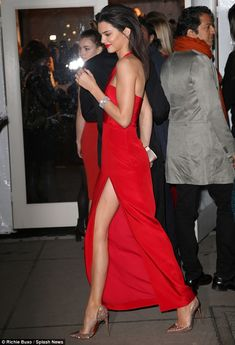 Red dress and red soles Kendall Jenner looks runway ready in thigh-high split gown #dailymail