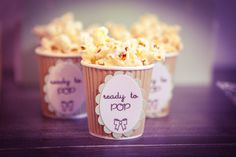 baby shower popcorn (Popping corn in mason jars with instructions & 'Caroline's almost ready to pop' on the front.)