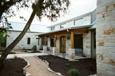 Hill Country Estate with Rustic Touches, Cactus, Limestone and Cedar accents