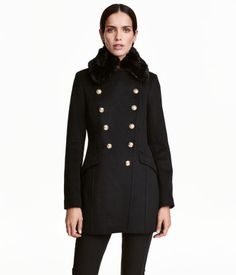 H&M $119 Black. Fitted, double-breasted jacket in a wool blend with a detachable faux fur collar. Gold-colored metal buttons at front and pockets with flap. Lined. $119