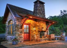 What a cool stone cottage with the fireplace and mantle on the small front porch. That is so charming.