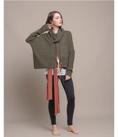 I love the mixtures of these colors and the neck on this poncho. With high-waisted pants this look would be perfect for work.