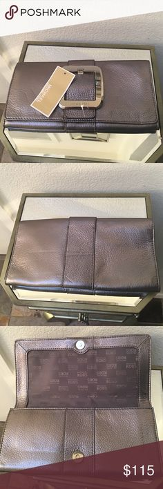 New with tags Michael Kors clutch Gun metal grey Michael Kors  leather clutch new/unused. 10.5inches along the bottom and 5.5inches from top to bottom. Michael Kors Bags Clutches & Wristlets