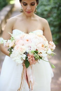 The wedding is just as pretty as this bride and her #bouquet   See more on SMP: http://www.StyleMePretty.com/pennsylvania-weddings/philadelphia/2014/01/28/vintage-modern-philadelphia-wedding-at-front-palmer/ Alison Conklin Photography