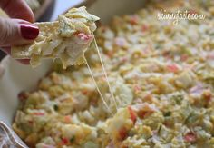 Hot and Cheesy Crab and Artichoke Dip - Hot and cheesy imitation crab and artichoke dip, serve this with baked chips and you have the perfect appetizer for a party. View the recipe details!