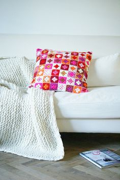 brightly colored pillow (no pattern but there's another close up photo from which the pattern may be deduced)