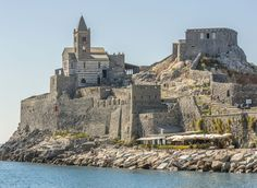 San Pietro Church Porto Venere, Italy Italy Trip Ideas Sea promontory Coast fortification castle building sky water history château ancient history Ruins rock cliff