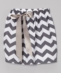 Little ones will feel totally groovy in this zigzagging cotton skirt. With its easy elastic waistband and ribbon adornment, it's a surefire way to brighten up any wardrobe.100% cottonMachine wash; tumble dryImported