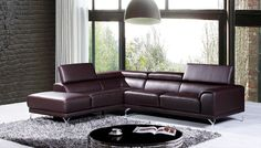 Divani Casa Wisteria Modern Brown Leather Sectional Sofa w/ Left Facing Chaise - VGKNK8214-TOP-BRN-LAFDescription :The Wisteria is upholstered in brown top grain leather where your body touches and split leather on the back. Angled chrome plated metal legs accent and support the Wisteria Sectional. Five adjustable headrests allow guests to control their comfort while the left facing chaise provides ample seating. The sleek design of the body and smooth leather texture completes the…
