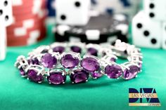 It's always important to have the sparkliest jewelry when you're winning big! This stunning African Amethyst bracelet is sure to make you feel lucky! [Promotional Pin]