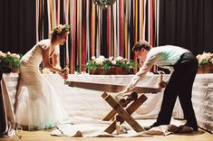 this couple celebrated the german tradition of sawing a log at their wedding!