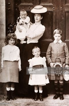 Queen Alexandra with her grandchildren, left to right: Princess Mary, Prince Henry, Prince George and Prince Edward of Wales (later King Edward VIII), circa 1905.