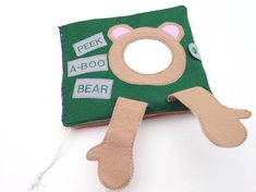 *MADE TO ORDER!! If you would like to have the childs name on the cover just send me a message with the name you would like! This 5 page felt book is perfect for any 1-2 year old! This book has many interactive learning activities including; peek-a-boo/cause and effect bear with mirror, texturized shape page, texturized frog with zip mouth, stretchy/elastic tongue and snap flies, counting/color matching caterpillar with snaps (perfect for strengthening and hand/eye coordin...