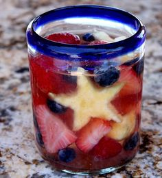 Red, White and Blue Sangria features strawberries, blueberries and pineapple chunks. Instead of the traditional splash of brandy, this recipe calls for triple sec.