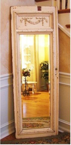install a mirror in an old door!  Genius!  Have to do this!