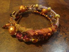 Spicy  Czech Glass and Silk Sari Stacked Bracelet on Etsy, $45.00