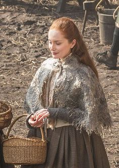 Lotte Verbeek as Geillis Duncan wearing her textured cape that looks like moss. | Costume designer TERRY DRESBACH | Outlander on Starz