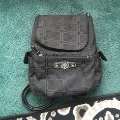 """Mini Backpack/Bag This is a black mini backpack with a cute pattern. It was used a few times so it has some """"fraying"""" on the material that can be seen in the last photo. Aside from that, the bag is in very good condition. Bags"""