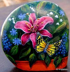 handpainted rocks, decorative stones, garden accents, butterflies, lilies, patio decor