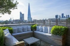 Rooftop in Bermondsey Built-in benches on London roof terrace, view towards the Shard Charlotte Rowe Garden Design