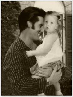 Elvis Presley with Lisa Marie at Graceland, 1969.