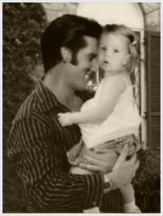 Elvis Presley with Lisa Marie at Graceland, 1969.