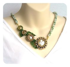 Hey, I found this really awesome Etsy listing at http://www.etsy.com/listing/106261832/floral-necklace-beaded-art-jewellery