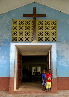 Boys at the entrance of a church in Vanuatu by Eric Lafforgue, via Flickr