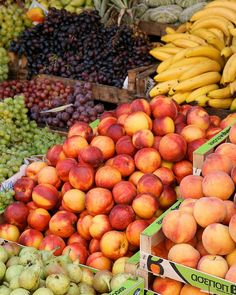 Nectarines, grapes, bananas, figs, peaches. All kinds of gorgeous fresh fruit for sale in this outdoor market in Corfu Greece. The colors are vibrant and fun, a perfect pick me up for your kitchen decor.