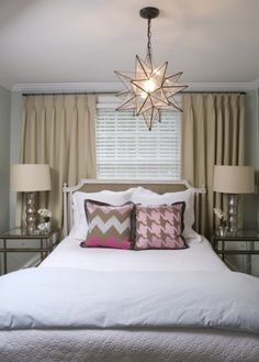 Liz Carroll Interiors - Chic guest bedroom bed in front of window curtains...expand curtains past window to make look bigger!