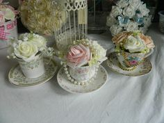 Stunning wedding flowers table centre peice teacup with flowers vintage