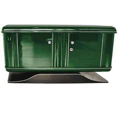 Illuminated Art Deco Dresser in Jaguar Racing Green | From a unique collection of antique and modern commodes and chests of drawers at https://www.1stdibs.com/furniture/storage-case-pieces/commodes-chests-of-drawers/
