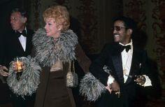 1973: Laughing alongside husband Gary Morton and singer Sammy Davis Jr. at a Friars Club benefit.