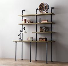 Black pipe workstation. For the dining room - narrow enough to be out of the way and can double as a buffet...