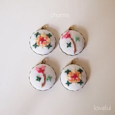 embroidered charms