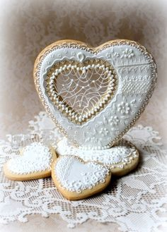 Staggeringly beautiful, immensely detailed wedding heart cookies. Stunning! #food #cookies #wedding #heart #decorated #lace #Valentines