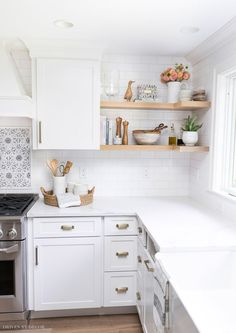 Open wood shelving that wraps around the corner - one of my favorite details of this kitchen remodel! #kitchen #kitchens #kitchenrenovation #kitchenreno #kitchenremodel #kitchendesign #kitchenideas #shelfstyling #shelves #openshelving #shelfie