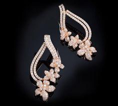 Rose Gold Diamond Earrings Diamond earrings set in 18K Rose gold.