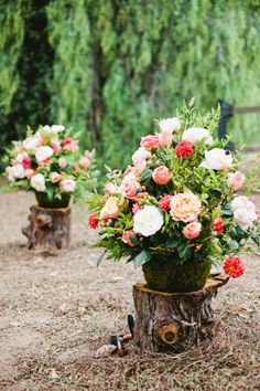 Rustic aisle marker floral arrangements in moss-covered pots. #forest #wedding #ideas