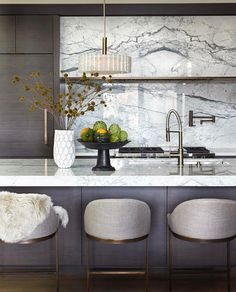 pretty modern kitchen love the stools with the marble open shelf area