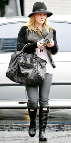 Look of the Day › January 23, 2010 WHAT SHE WORE Duff paired a Yigal Azrouel leather-and-knit jacket with Paige Denim jeans; she accessorized with Jimmy Choo for Hunter crocodile-print boots, a wide-brimmed hat and a motorcycle bag WHERE Out and about in L.A.