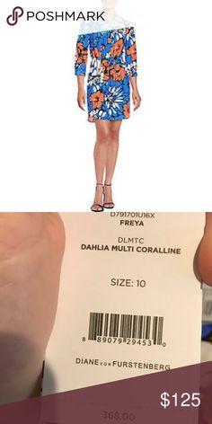 "DVF Freya 3/4 Silk Dress Drawstring waist adds dimension to a vibrant floral dress Split V-neckline Three-quarter sleeves Buttoned cuffs Drawstring waist Back pleat detail Curved hem. Silk Dry clean Imported Model shown is 5'10"" (177cm) wearing US size 4. Diane von Furstenberg Dresses Mini"