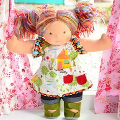 I have such a love of handmade dolls right now that I would love to own one of these.